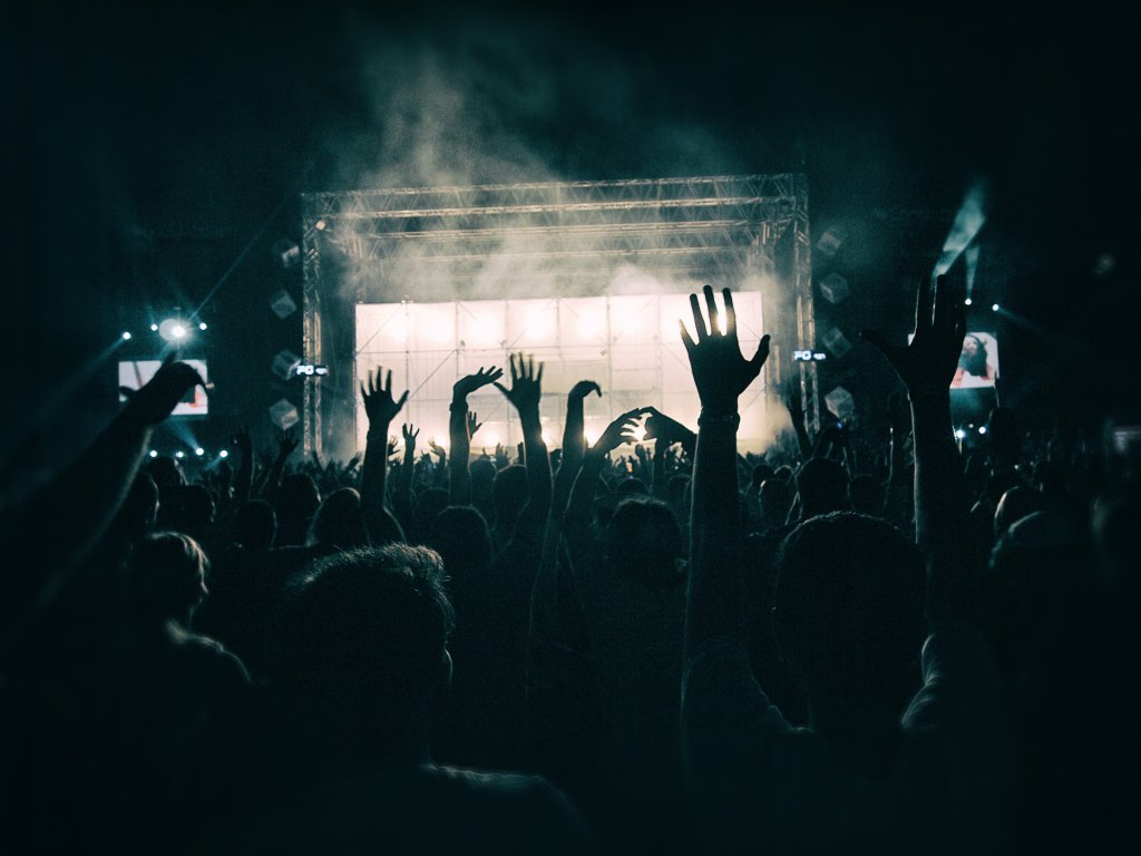 silhouetted hands in the air at concert | Schoolies preparation 2019 | HiRUM