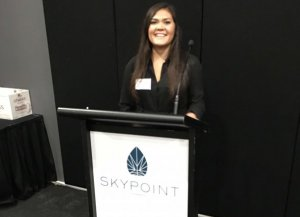 Brigitte Creencia from TrustYou presenting at industry event