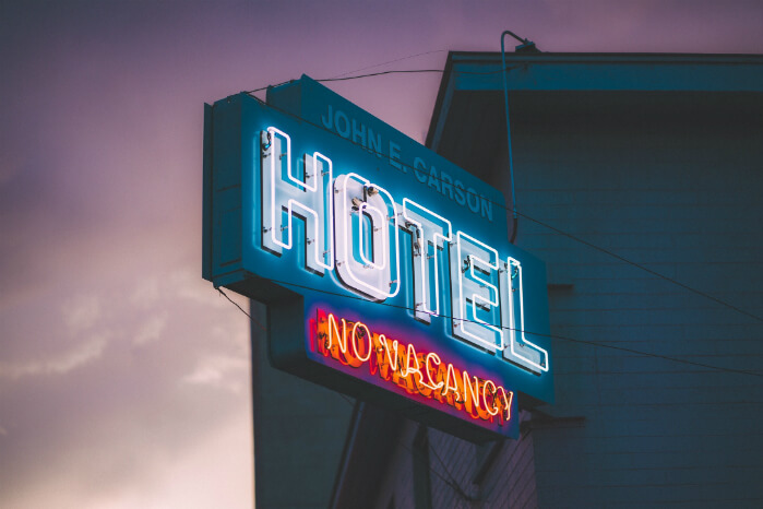 hotel no vacancy neon sign | channel management in the hotel industry | HiRUM