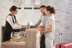 customer at hotel reception | customer service trends in hospitality | HiRUM