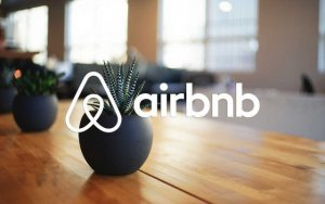 airbnb logo overlaid on image of dining table | features of airbnb | HiRUM