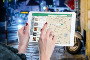 ladies using ipad to select restaurant | travel meta search engines explained | HiRUM