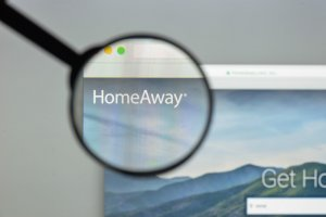 homeaway channel manager on a screen trough a magnifying glass | HiRUM
