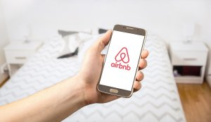 airbnb on a mobile phone | best channel manager for airbnb | HiRUM