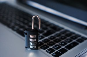 padlock by laptop keyboard | protect your business from internet security scams | HiRUM